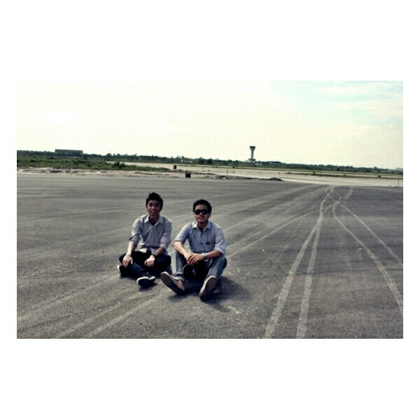 "Sitting at runway #KualanamuAirport , #Indonesia. This new airport was in construction when we ""#CivilEngineer"" team dispatched to take alook at it and surveying. heheh in this visits we are just sightseeing at it, not officialy supervise, the guy on my right was my friend and from the whole pack i think he's the one who narcist enough to asking a lot of photoshoot here and there. duh"