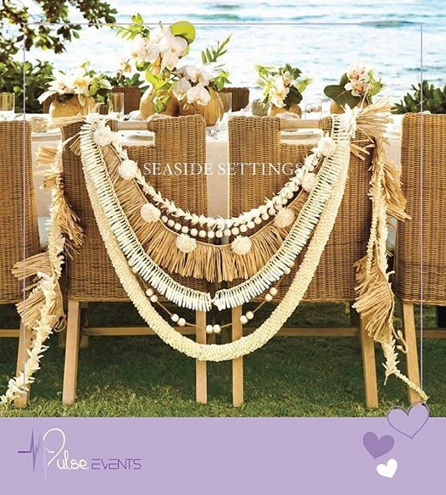 """Extra special Bride and Groom's Chairs draped with a stylish mix of monochromatic leis and garlands, including (from top) a tuberose lei, wooden beads, a cut grass skirt, a Micronesian ginger lei, more wooden beads, and a spiral orchid lei.  #Pulse_Events #sea_side #weddingplanner #eventplanning #creative #decoration #flowers #Bride #groom #Zaffeh #Bands #arrangement #UAE #Dubai #AbuDhabi #Centerpiece #Event_services #Love #catering #Zaffeh #events #Birthdays #Engagements #Ceremonies…"