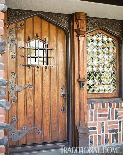 We love the historic details at the entrance of this Tudor-style home. Just look at that window! - Traditional Home ® / Photo: Karyn Millet / Design: Joe Lucas and Parrish Chilcoat