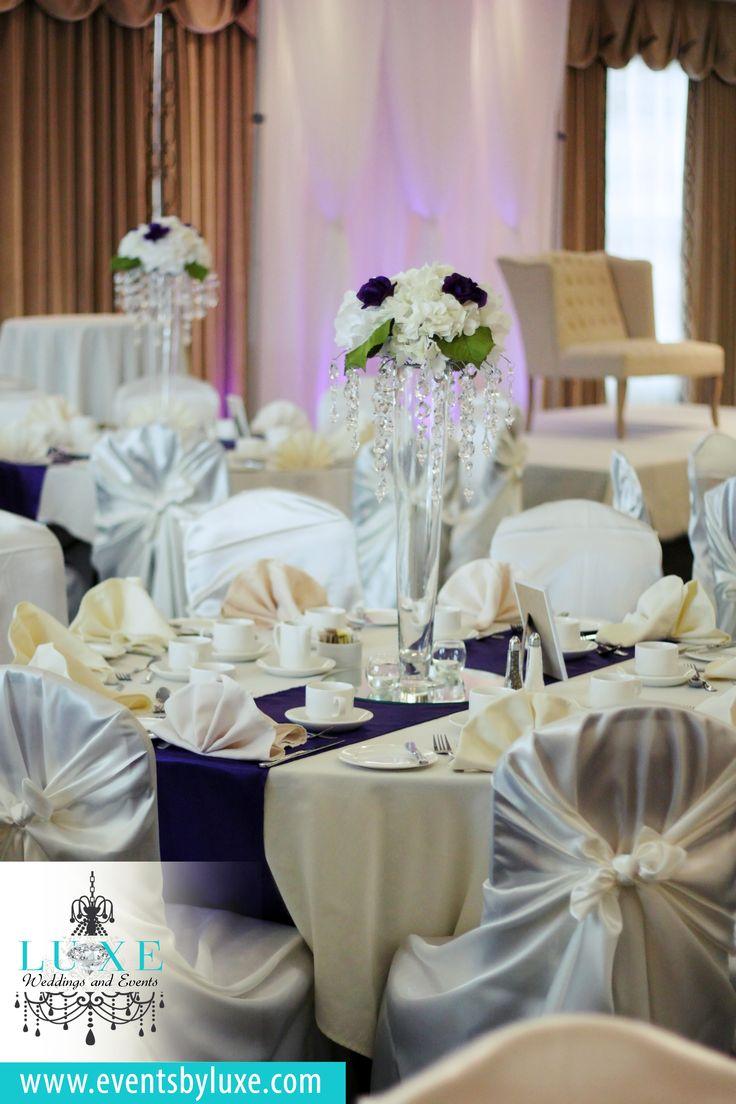 Ivory and purple wedding decor, hydrangea centerpieces, hydrangea with roses centerpiece, tall wedding centerpiece, crystal wedding centerpiece, white wedding backdrop with uplighting, ivory and purple wedding reception