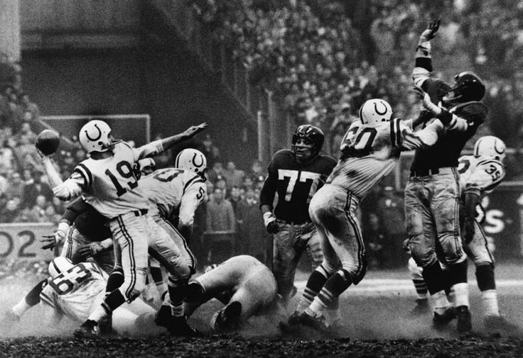 Robert Riger photographed this moment in 1958 during the National Football League championship as Baltimore Colts quarterback Johnny Unitas made a pass against the New York Giants. I see football as a pretty rough sport and this photograph captures it's essence.