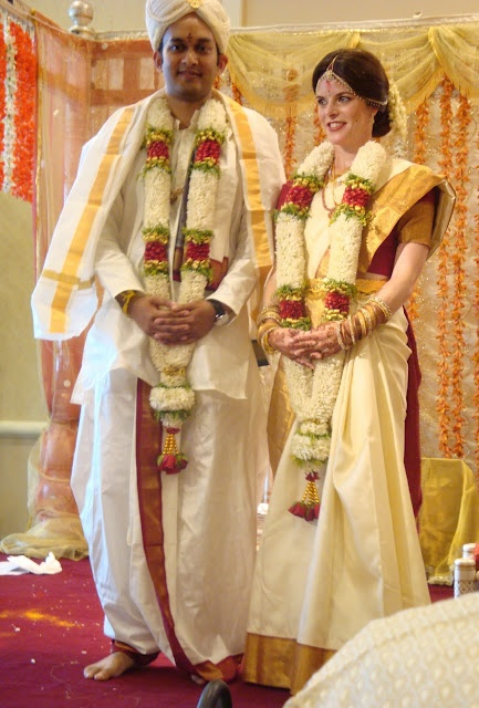 The couple seeks blessings from the family and friends. Flower petals and rice are then given to family and friends to shower upon them. With the blessings, the wedding ceremony has now concluded.