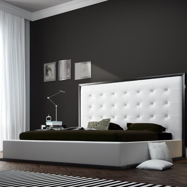 Features: -Constructed from solid hardwood and MDF. -Upholstered in bonded leather. -Lavish button-tufted headboard stands five feet tall. Frame Material: -Manufactured wood/Wood. Headboard Inclu