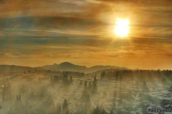 Siriu mountains. Smoke and sun