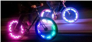 http://www.bellsandwhistles.co.nz/collections/all-products/products/monkeylectric-m210-light MonkeyLectric M210 Bicycle Spoke Light, Bike Light. The Monkey light includes 20 themes with hundreds of colour combinations. The 10 LED light board hooks to 2 of your spokes using 3 point zip ties and attaches to a hub-mounted 3AA battery pack. #spokelight #monkeylectric #bicyclelight #bikelight