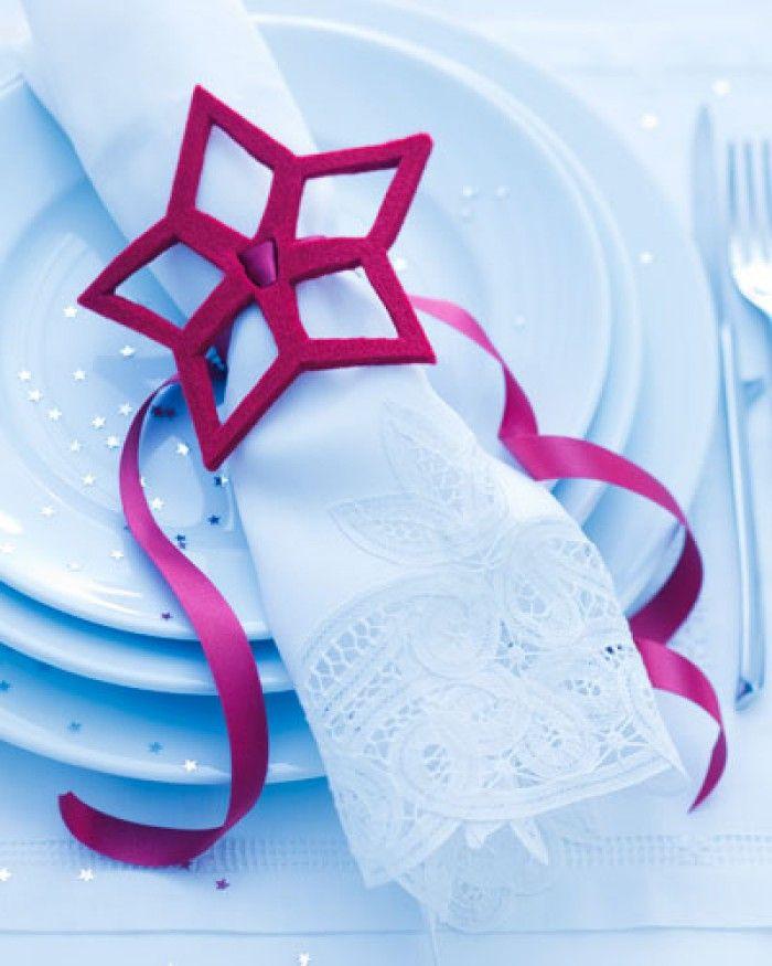 De servetster is de finishing touch op een mooi gedekte kersttafel.