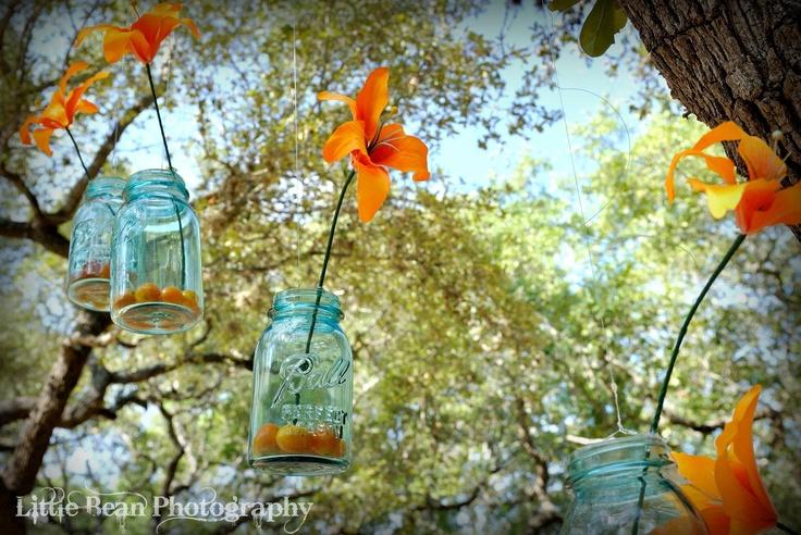 blue mason jar, (fake) orange asiatic lily, kumquats, suspended with fishing line