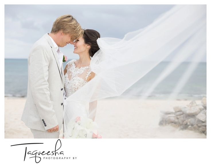 Bridal portraits on the beach, I love veils, especially for beach weddings. You can create drama as well as frame the bride and groom with it.  Destination wedding at the Grand Bahai  Photography by Taqueesha