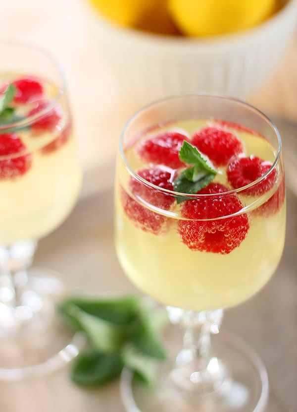 Limoncello + prosecco cooler with raspberry ice cubes.