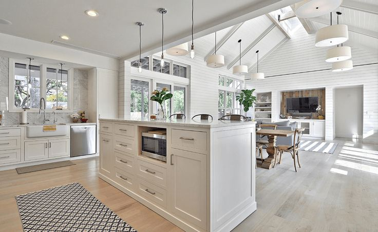 White Kitchen With Vaulted Ceilings - An all-white design is enhanced by vaulted ceilings and lots of natural light