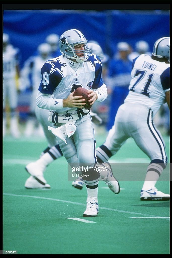 1994: Dallas Cowboys quarterback Troy Aikman drops back to pass during game against the New York Giants at Giants Stadium in East Rutherford, New Jersey. Mandatory Credit: Bill Hickey /Allsport