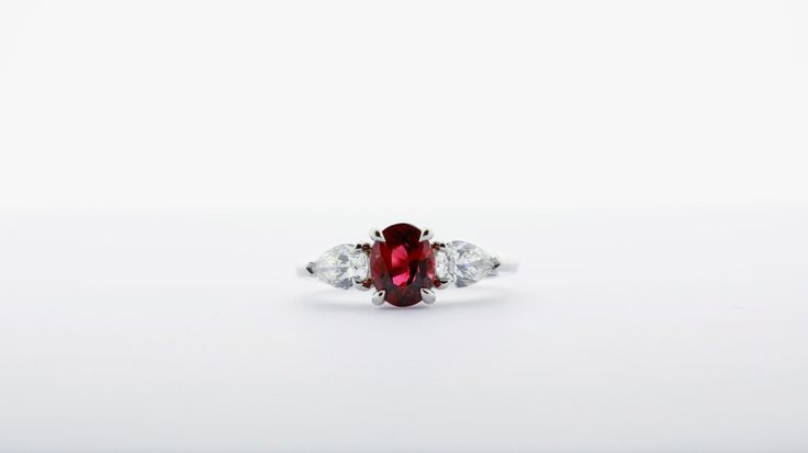 A tailor made variant of our classic diamond & ruby trilogy ring (code CR-GW-RA-0045R). Have yourself inspired by classic models and give them a twist of your own by ordering a tailored version like this one where the round ruby was replaced by an oval ruby set with tiger claws instead of round prongs and pear shaped side diamonds | Vintage jewellery, suited for all ocassions, anniversary gift, achievement celebration, graduation present or as diamond engagement ring.