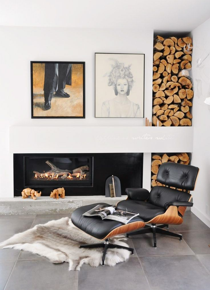 Fireplace and wood storage with Eames lounge chair