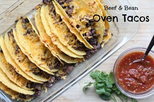 Beef & Bean Oven Tacos Recipe with ground beef, onions, black beans, taco seasoning, diced tomatoes, taco shells, shredded cheese, corn, avocado, guacamole, shredded lettuce, salsa