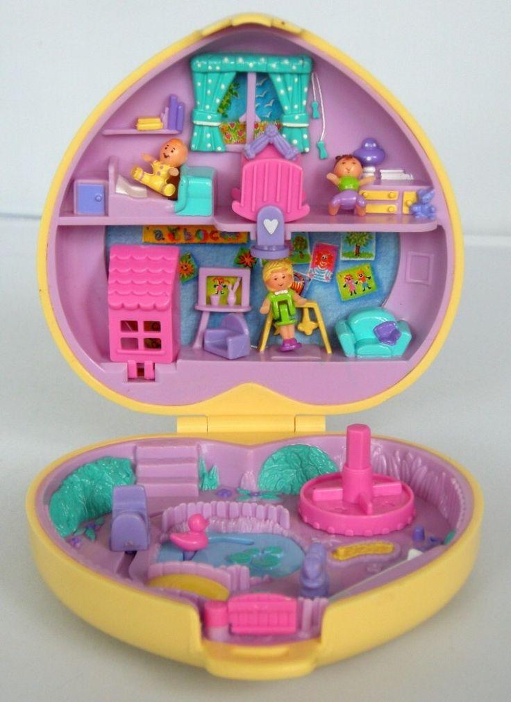 Image from http://imgs.inkfrog.com/pix/bestlaw_goods/Polly_Pocket_bluebird_1994_amusement_park_10X10cm-1.JPG.