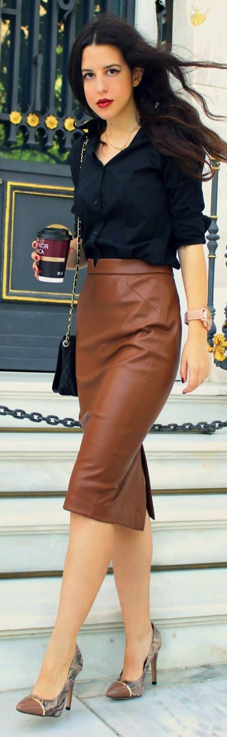 camel-colored leather skirt, black blouse, print heels