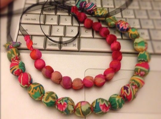 Tube method of making a fabric covered bead necklace.  (I think t-shirt fabric would be ideal.)