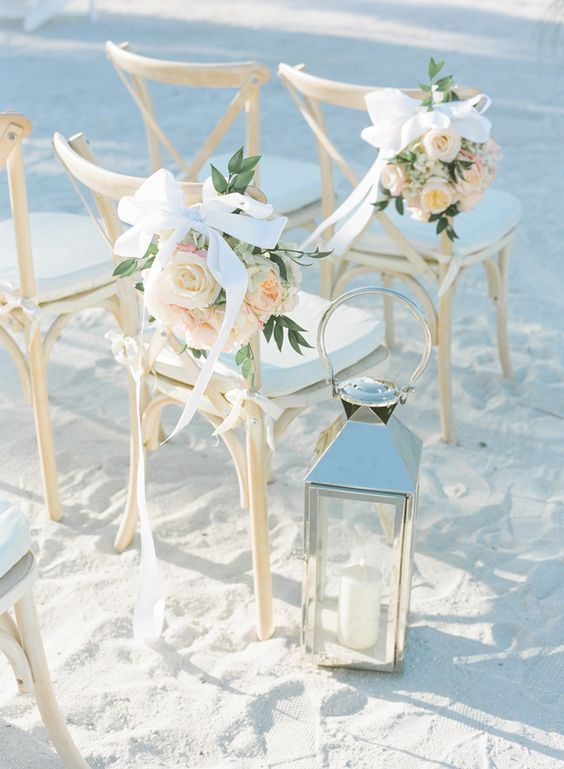 blush beach wedding chair  / http://www.himisspuff.com/wedding-chair-decor-ideas/9/