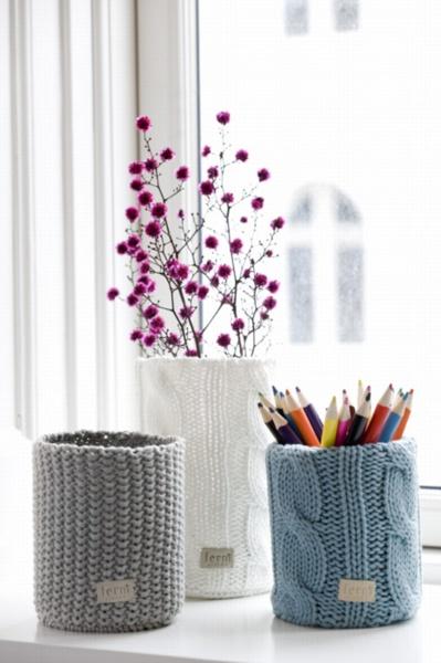 sweater pencil jars in a winter window.