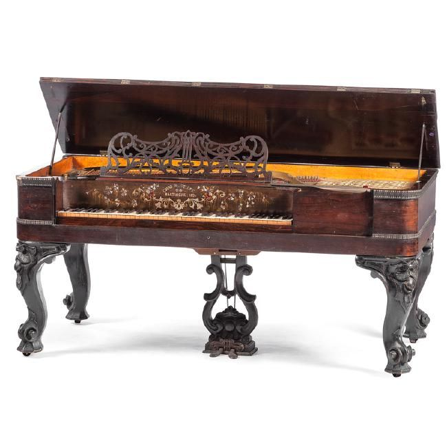 American, late 19th century. A square grand piano marked above keys Chas. M. Steiff / Baltimore Md. in inlaid mother of pearl. The piano is of Brazilian rosewood construction, raised on carved cabriole legs; ht. 36, wd. 80.5, dp. 36 in.