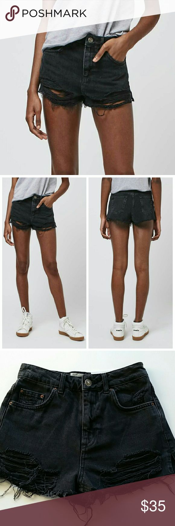 "Topshop Moto High Waisted Ripped Mom Jean Shorts Topshop moto high waisted mom shorts  *US 4 but runs small and fits more like 0-2. Therefore labeled as size 0. Please check measurements. *Waist : 12.5"" flat / Inseam : 1.5""  *Slightly washed out black color *Distressed/Ripped  *New with tags *No trade Topshop Shorts Jean Shorts"