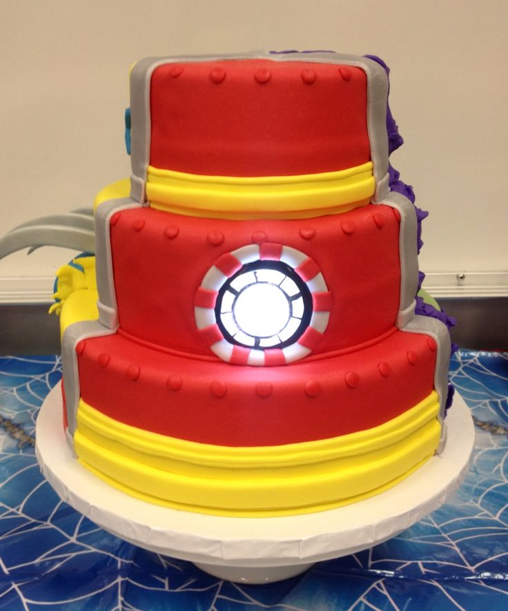 Iron Man cake. Three superheroes on one cake: Wolverine, Iron Man, The Hulk.  Arc reactor core lit up with LED light.