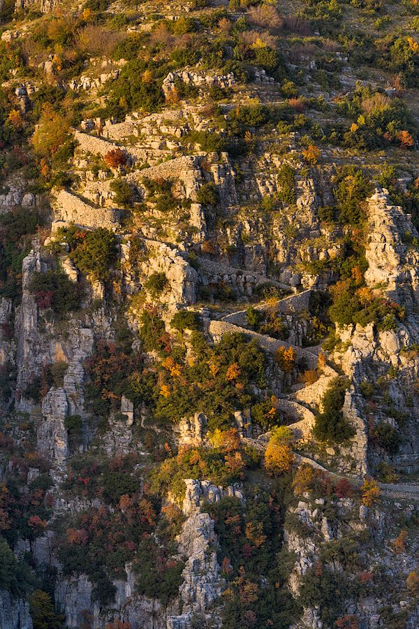 Vradeto Stairs in the Vikos - Aoos National Park, Epirus Greece. The stairs were the only way until 1974 to get from Vradeto village, located at the highest point in Zagori, to Kapesovo village. The path starts just outside Kapesovo and goes down to Mezaria. From there the stone stairs start and after 1200 meters it leads to the entrance of the village at an altitude of 1340 meters.
