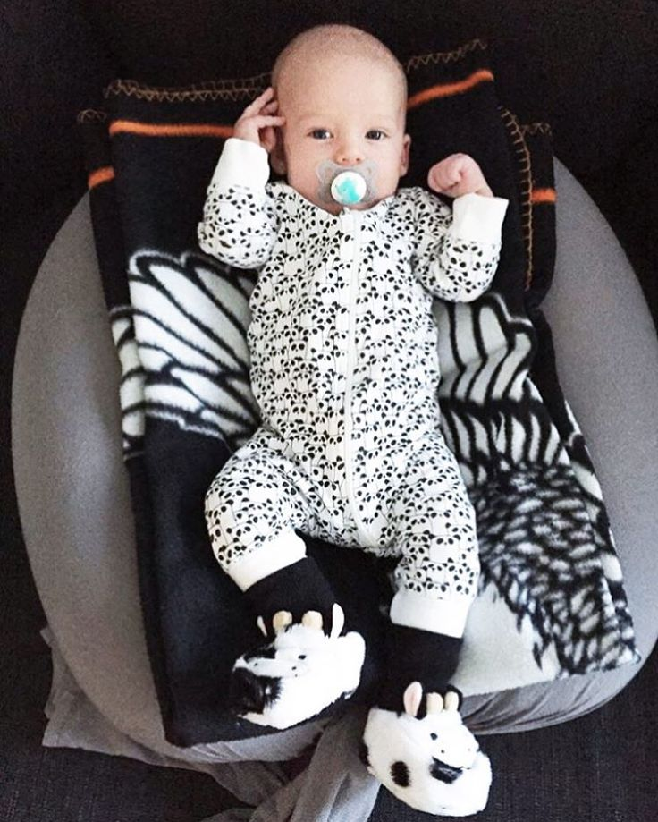 Handsome baby Elis, freshly bathed and now relaxing in his throne #bbhugme! His baby slippers are also on point