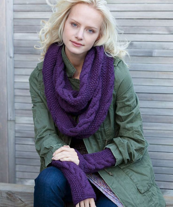 """Infinity Trinity Cowl and Wristers Knitting Pattern  Be the warmest girl in town–or even in the country– with this cozy cabled duo. The infinity scarf is the """"it"""" must-have accessory and can be worn as a scarf, a cowl or even over bare shoulders for night wear..  Red Heart Free Pattern - no membership required."""