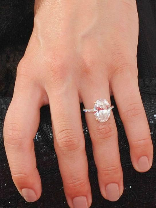 Does Julianne Hough's oval engagement ring remind you of a sparkler that belongs to another celebrity...? Click and see who we're thinking