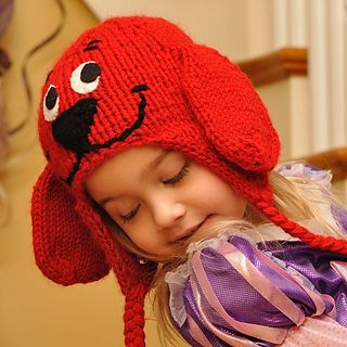 "This adorable dog hat will keep your child's head very warm during the cold winter months. The main portion of the hat uses double-stranded yarn, so divide a skein into two balls. Do not double the yarn while knitting the earflaps or the ears. They will automatically double because of the knitting techniques used. A Turkish Cast-on* was used for the earflaps to prevent the ends from curling out. It also gives the hat a finished look. Hobby Lobby's ""I Love This Yarn"" (worsted – 100% acrylic)…"
