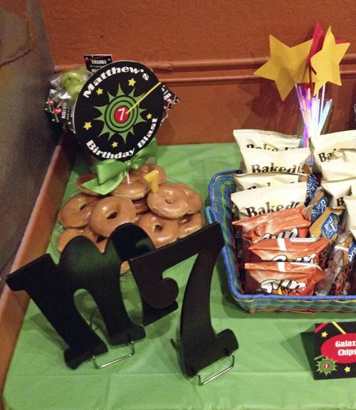 """Laser Tag Party Table for 7th Birthday Blast!  """"Target"""" Centerpiece topper and tent style food labels by That Party Chick.  For details on this party and party printables visit www.thatpartychick.net"""
