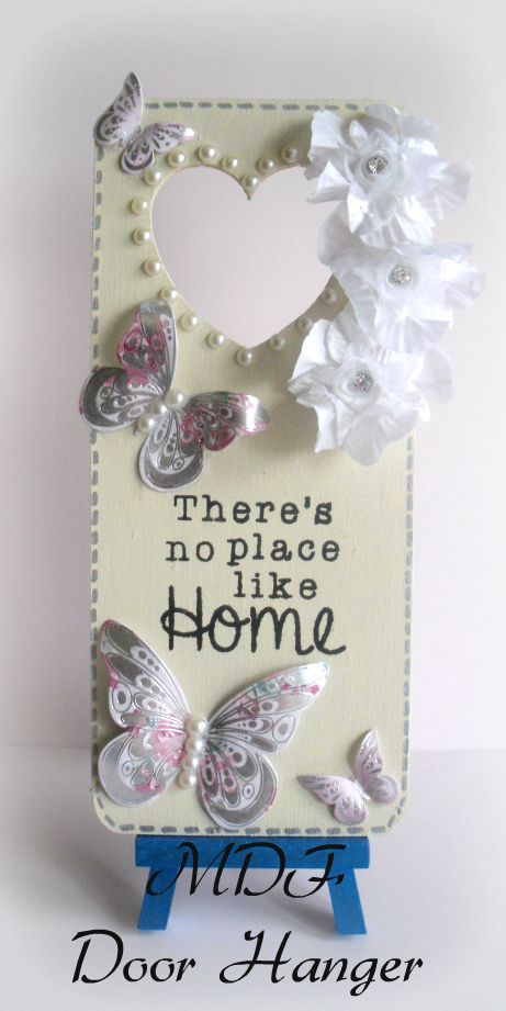 MDF Door Hanger been painted with vintage chalk paint colour vintage cream, I have also used dreamees pearls and stamps I also added kanban butterflies and some flowers.