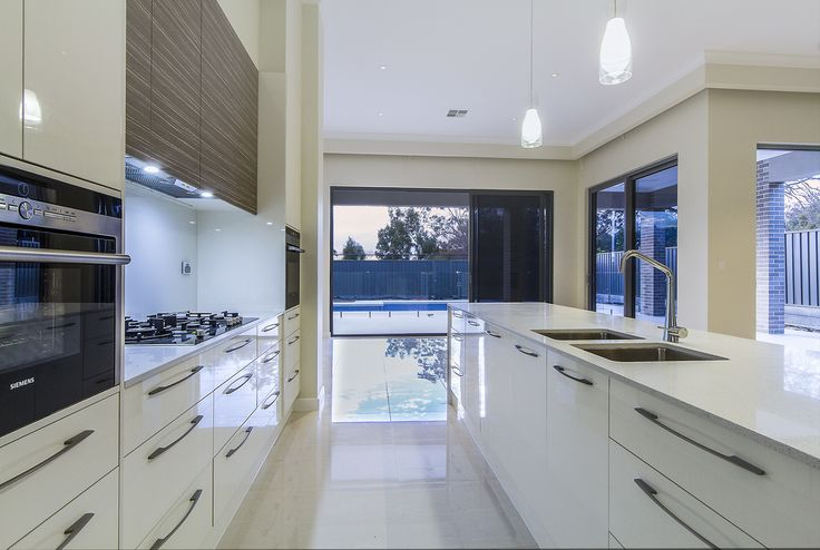 2pac kitchen featuring stone benchtops and feature laminate overhead cupboards  Kitchen is a part of our Linden Park project