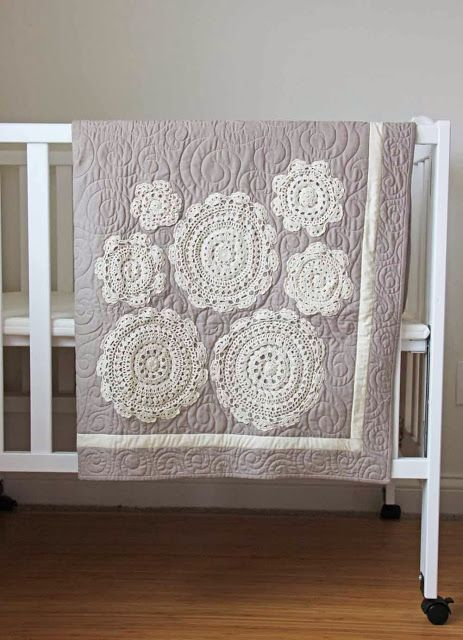 Love this quilt!! And the actual quilting goes so well with the doilies. How cute would this be with some of her ombre fabric?!