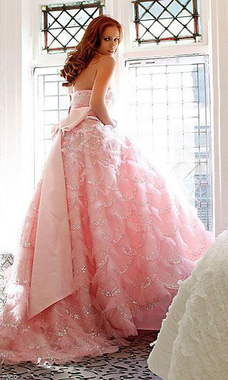 Pink princess style wedding gown with lovely bow