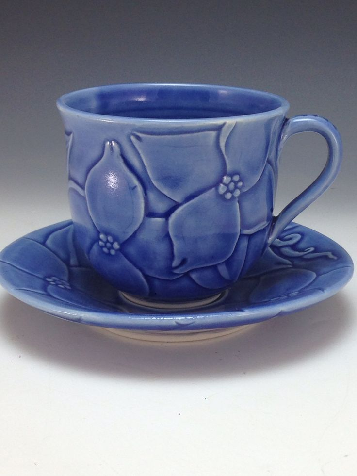 Tea cup and saucer  Stylized dogwood design Bas relief carving Anne Webb #demitasse #porcelain #basrelief #pottery
