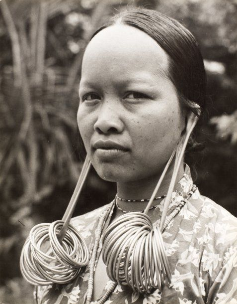 Indonesia | Dayak woman with elongated ear lobes.  ca. 1950 | ©A Martin