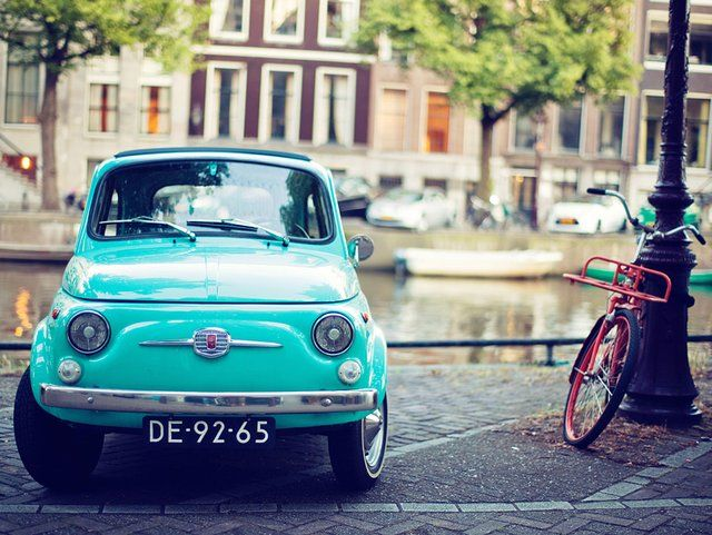 Fiat 500, my very first car was a fiat. t so cute, it was a red sedan, with blue jean seats