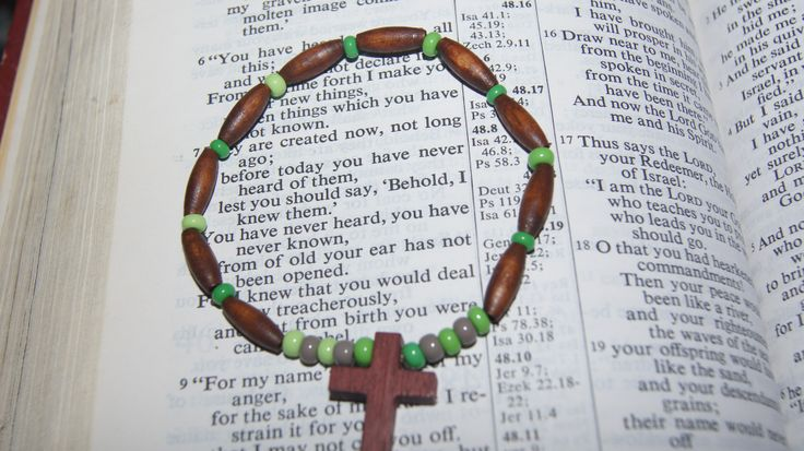 Cross Rosary style bracelet. https://www.etsy.com/listing/122582645/wooden-cross-crucifix-green-with?ref=shop_home_active_22