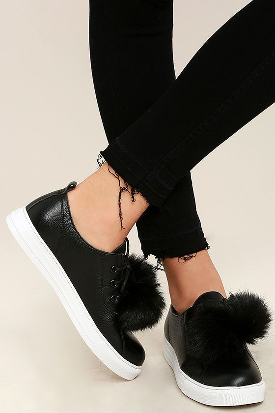 "Accessorize from head to toe in the Dirty Laundry Fluffed Up Black Leather Pompom Sneakers! Two black faux fur pompoms are strung through the laces of these leather sneakers with a pull tab at back. 1"" white bumper sole."