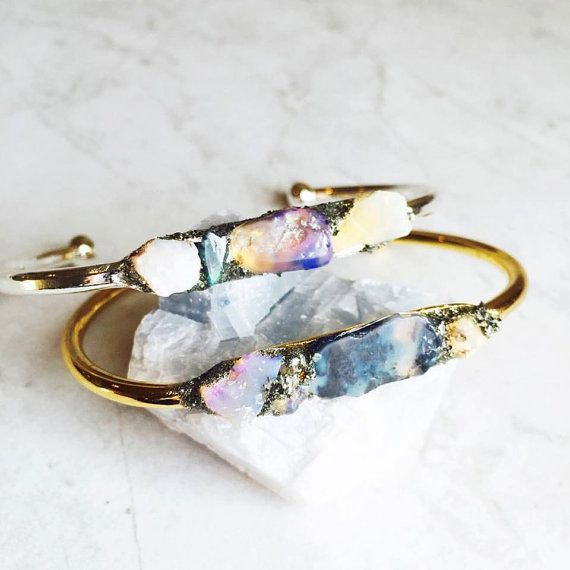 This one of a kind fascinating bracelet is made with 100% Natural Australian Lightning Blue Opal with natural crushed Pyrite on silver plated lead &
