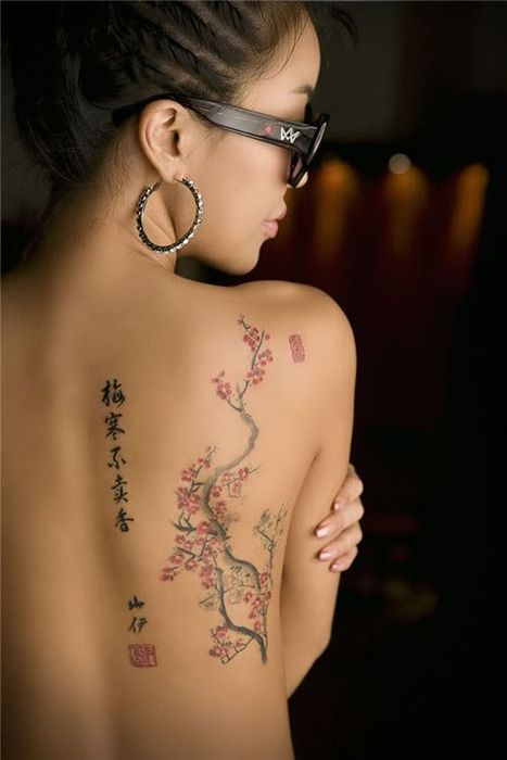 Cherry Blossom Back Tattoo. But no words. Cuz we all know that tattoo people lie and put hilarious phrases on us.