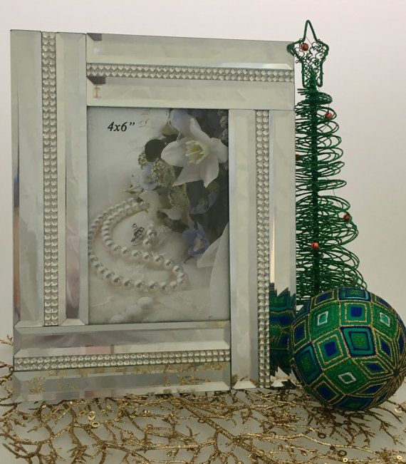 """Abstract Mirrored  Photo Frame With Crystal Inlay 4 X 6      Features        Photo frame - modern and simple      Great for displaying those special moments and precious memories      Portrait      Fits picture size 4"""" x 6""""      Frame Size: 19.5cm X 24.5cm    Package Contents        1 x Photo frame       1 x White Box    Only $30.00 plus Shipping World Wide 
