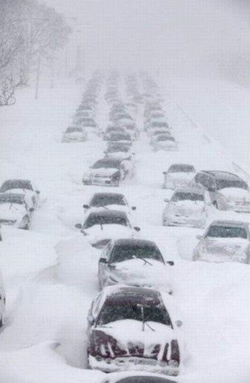 Chicago Snowstorm... remember that all too well! Do not miss  getting stuck in the snow and needing help getting my car to drive