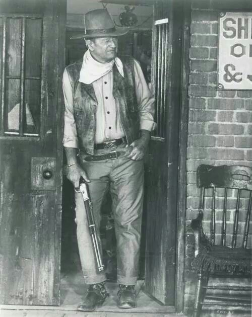 John Wayne and his Winchester 1892 carbine in the filming of El Dorado.