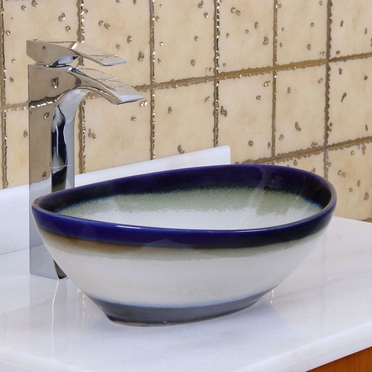 This gorgeous ceramic sink features a unique design and beautiful colors that are sure to enhance the look of your bathroom decor.