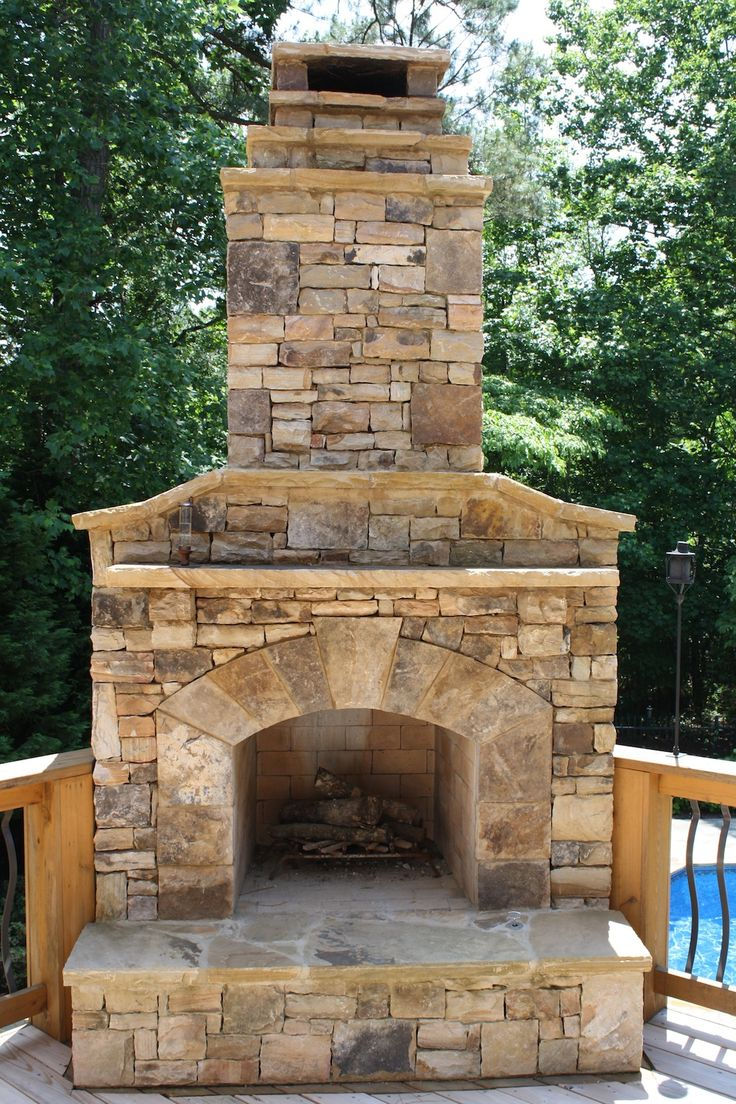 Outdoor Stone Fireplace on Wood Deck