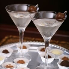 Chocolate Martini - 1 oz Creme de cacao (clear) 1 oz Vodka. Rim glass with chocolate and serve with dark chocolate swizzle stick.