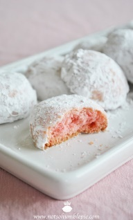 Pink Peppermint Tea Cookies  yields roughly 40 cookies  1 cup (2 sticks) unsalted butter  1 cup powdered sugar  1 drop red food coloring gel  1 1/4 teaspoons peppermint extract  2 cups all purpose flour  1/4 cup rice flour  1/4 teaspoon salt  2 tablespoons crushed peppermint candies  1 tablespoon very coarse red sugar*    1 cup powdered sugar for coating